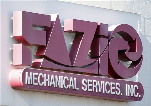A sign for Fazio Mechanical Services Inc. is at their location in Sharpsburg, Pa. on Friday, Feb. 7, 2014.