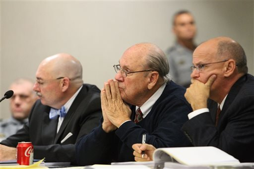 Former Tampa Police captain Curtis Reeves, Jr., center, sits beside his defense attorneys Richard Escobar, right, and Dino Michaels as they listen to his taped interview by detectives during his bond reduction hearing before Circuit Judge Pat Siracusa.
