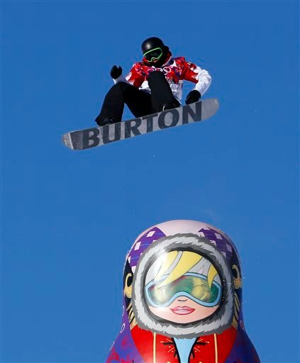 Canada's Mark McMorris takes a jump during the men's snowboard slopestyle semifinal at the Rosa Khutor Extreme Park, at the 2014 Winter Olympics, Saturday, Feb. 8, 2014, in Krasnaya Polyana, Russia. (AP Photo/Sergei Grits)