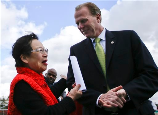 In a Monday, Feb. 3, 2014 photo, San Diego mayoral candidate Kevin Faulconer engages in conversation with supporter Lilly Cheng during a campaign event, in San Diego.