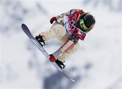 Jamie Anderson of the United States takes a jump on her first run in the women's snowboard slopestyle final at the 2014 Winter Olympics, Sunday, Feb. 9, 2014, in Krasnaya Polyana, Russia. (AP Photo/Andy Wong)