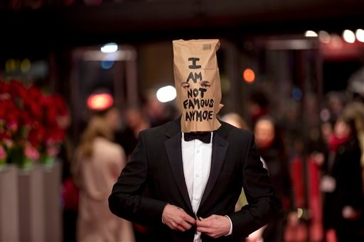 Actor Shia LaBeouf poses for photographers, with a paper bag over his head that says 'I am not famous anymore' on the red carpet for the film Nymphomaniac at the International Film Festival Berlinale in Berlin, Sunday, Feb. 9, 2014.