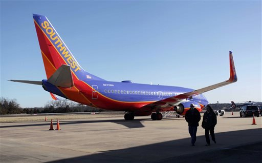 In this Jan. 13, 2014 file photo, Southwest Airlines Flight 4013 sits at the M. Graham Clark Downtown Airport in Hollister, Mo.