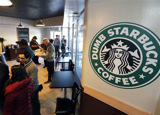 People wait at Dumb Starbucks coffee in Los Angeles Monday, Feb. 10, 2014. (AP)