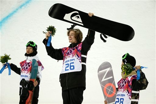 Switzerland's Iouri Podladtchikov, center, celebrates his gold medal in the men's snowboard halfpipe final as he is flanked by silver medalist Ayumu Hirano, left, of Japan, and bronze medalist Taku Hiraoka, also of Japan, at the 2014 Winter Olympics.