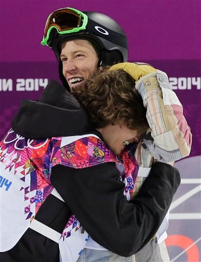 Switzerland's Iouri Podladtchikov, bottom, celebrates with Shaun White of the United States after Podladtchikov won the gold medal in the men's snowboard halfpipe final at the Rosa Khutor Extreme Park.