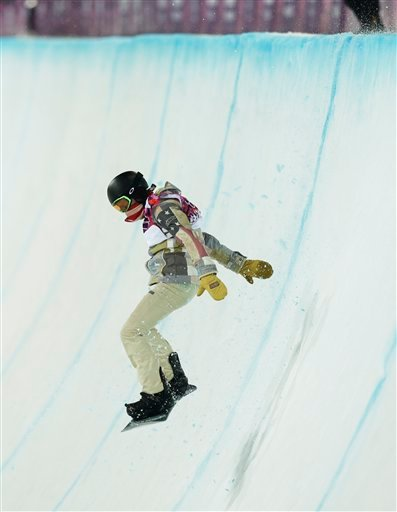 Shaun White of the United States bounces off the edge of the half pipe during the men's snowboard halfpipe final at the Rosa Khutor Extreme Park, at the 2014 Winter Olympics, Tuesday, Feb. 11, 2014, in Krasnaya Polyana, Russia.