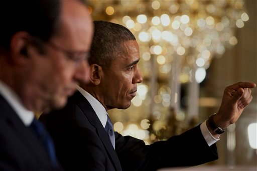 French President Francois Hollande listens as President Barack Obama speaks during their news conference in the East Room of the White House in Washington, Tuesday, Feb. 11, 2014. (AP)