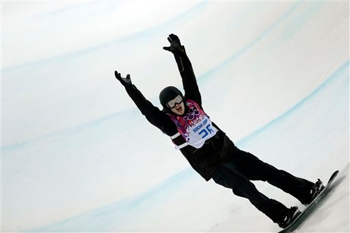 Switzerland's Iouri Podladtchikov celebrates after his second half pipe run during the men's snowboard halfpipe final at the Rosa Khutor Extreme Park, at the 2014 Winter Olympics, Tuesday, Feb. 11, 2014, in Krasnaya Polyana, Russia. (AP)