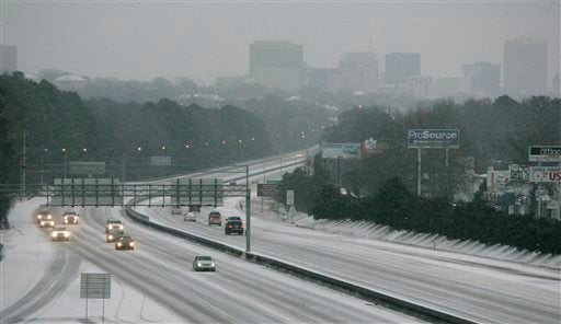 Ice and snow cover Interstate 26, early Wednesday, Feb. 12, 2014, in Columbia, S.C. Gov. Nikki Haley again declared a state of emergency. (AP Photo/Mary Ann Chastain)