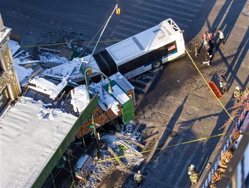 A Metropolitan Transportation Authority bus and a truck rest against scaffolding at 14th Street and 7th Avenue in New York, Wednesday, Feb. 12, 2014. (AP Photo/Craig Ruttle)