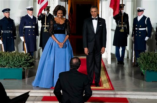 First lady Michelle Obama, left, and President Barack Obama welcome French President François Hollande for a State Dinner at the North Portico of the White House on Tuesday, Feb. 11, 2014, in Washington. (AP Photo/ Evan Vucci)