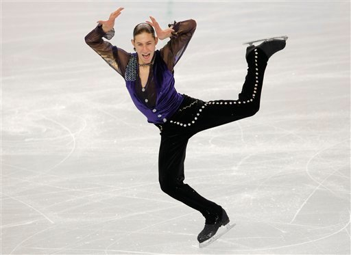 Jason Brown of the United States competes in the men's short program figure skating competition at the Iceberg Skating Palace during the 2014 Winter Olympics, Thursday, Feb. 13, 2014, in Sochi, Russia. (AP Photo/Vadim Ghirda)