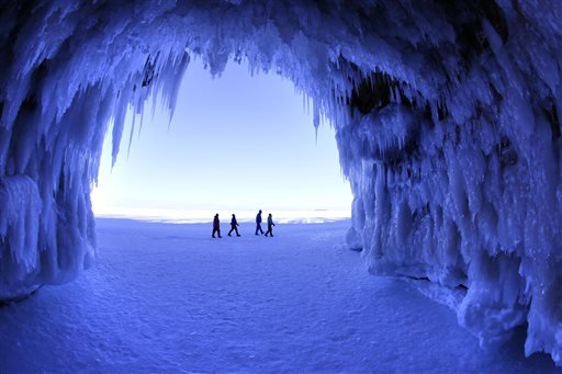 Feb. 2, 2014 photo: people walk past a cave at Apostle Islands National Lakeshore in northern Wisconsin. (AP Photo/The Minneapolis Star Tribune, Brian Peterson)