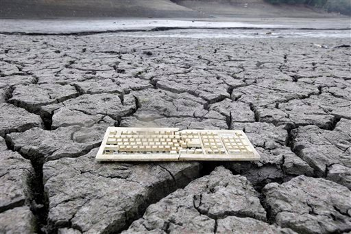 A discarded computer keyboard lies on the dry, cracked bed of the Almaden Reservoir in San Jose, Calif. on Friday, Feb. 7, 2014 during the state's worst drought in recorded history. (AP Photo/Marcio Jose Sanchez)