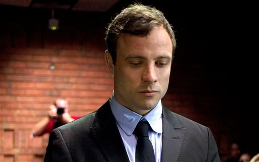 In this file photo taken on Monday, Aug, 19, 2013, Oscar Pistorius, the celebrated athlete who became a murder suspect, said Friday, Feb. 14, 2014 that he is consumed by grief on the first anniversary of the day that he fatally shot his girlfriend.