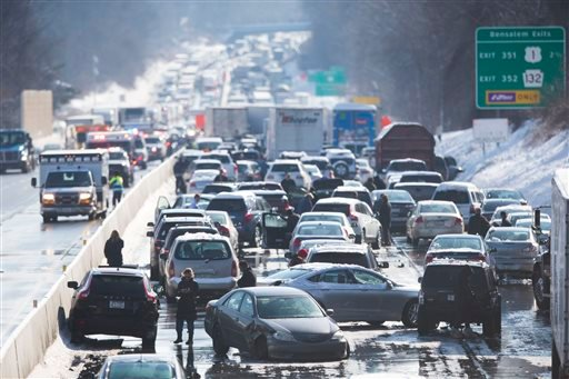 Vehicles are piled up in an accident Friday, Feb. 14, 2014, in Bensalem, Pa. Traffic accidents involving multiple tractor trailers and dozens of cars have completely blocked one side of the Pennsylvania Turnpike. (AP Photo/Matt Rourke)