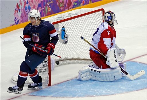USA forward T.J. Oshie scores a goal in a shootout against Russia during a men's ice hockey game at the 2014 Winter Olympics, Saturday, Feb. 15, 2014, in Sochi, Russia. (AP Photo/Petr David Josek)