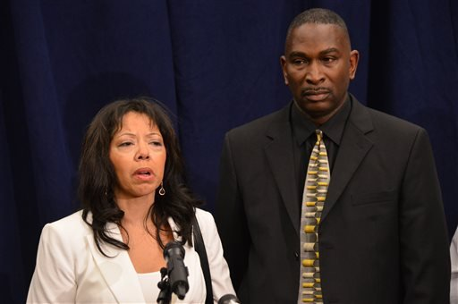 Jordan Davis' parents, Lucia McBath, left, and Ronald Davis, speak to the media after the verdict was read in the trial of Michael Dunn, Saturday, Feb. 15, 2014, in Jacksonville, Fla.