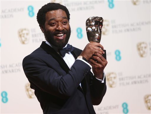 Chiwetel Ejiofor winner of best actor poses for photographers in the winners room at the EE British Academy Film Awards held at the Royal Opera House on Sunday Feb. 16, 2014, in London. (Photo by Joel Ryan/Invision/AP)