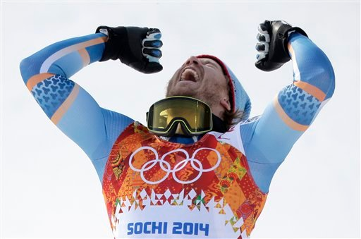 Norway's Kjetil Jansrud celebrates on the podium after winning the gold medal in the men's super-G at the Sochi 2014 Winter Olympics, Sunday, Feb. 16, 2014, in Krasnaya Polyana, Russia. (AP Photo/Charlie Riedel)