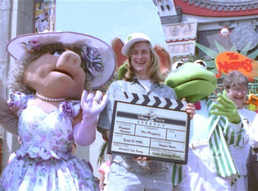 Puppeteer John Henson, the son of the late Muppets creator Jim Henson is seen with Muppets Miss Piggy and Kermit at the Disney/MGM studios in Lake Buena Vista, Florida in this June 15, 1990 file photo.