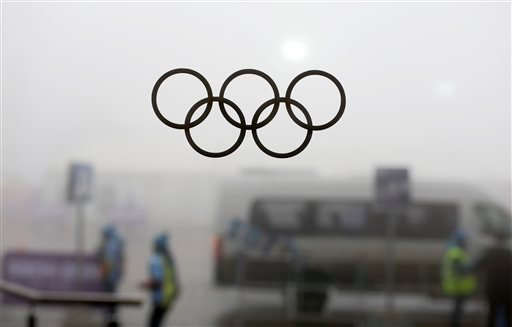 Olympic rings on a window are silhouetted against thick fog at the Laura Biathlon centre at the 2014 Winter Olympics, Monday, Feb. 17, 2014, in Krasnaya Polyana, Russia.