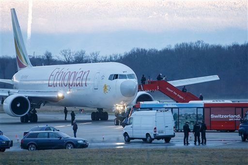 Passengers are evacuated from a hijacked Ethiopian Airlines Plane on the airport in Geneva, Switzerland, Monday, Feb. 17, 2014.