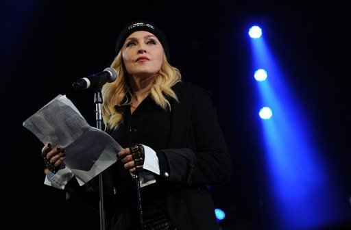 "In this Feb. 5, 2014 file photo, Madonna participates in Amnesty International's ""Bringing Human Rights Home"" Concert at the Barclays Center in New York."