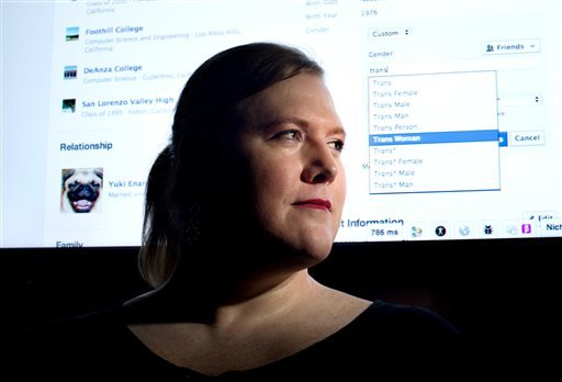 In this Wednesday, Feb. 12, 2014, Facebook software engineer Brielle Harrison demonstrates Facebook's expanded options for gender identification at her company's Menlo Park, Calif., headquarters.