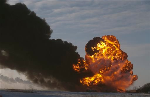 In this Dec. 30, 2013, file photo, a fireball goes up at the site of an oil train derailment in Casselton, N.D.