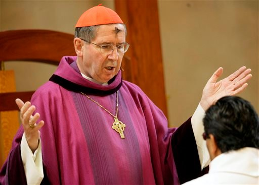 In this Feb. 6, 2008 file photo, Cardinal Roger Mahony officiates during Ash Wednesday services at the Cathedral of Our Lady of the Angels in Los Angeles. (AP Photo/Nick Ut, File)