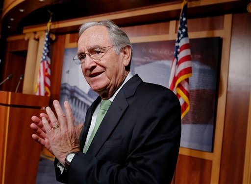 FILE - In this Nov. 7, 2013 file photo, Sen. Tom Harkin, D-Iowa speaks with reporters on Capitol Hill in Washington. (AP Photo/J. Scott Applewhite, File)