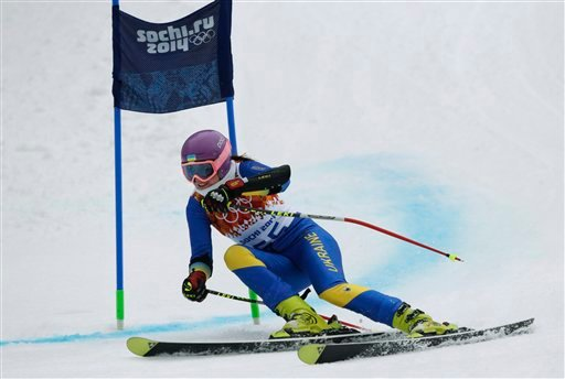 In this Saturday, Feb. 15, 2014 photo, Ukraine's Bogdana Matsotska passes a gate in the women's super-G at the Sochi 2014 Winter Olympics in Krasnaya Polyana, Russia. (AP Photo/Charles Krupa)