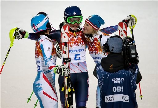 Women's slalom medalists, from left, Austria's Kathrin Zettel (bronze), United States' Mikaela Shiffrin (gold) and Marlies Schild (silver), celebrate at the Sochi 2014 Winter Olympics, Friday, Feb. 21, 2014, in Krasnaya Polyana, Russia.(AP Photo)