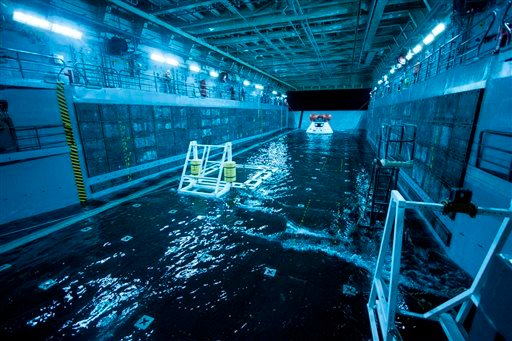 This Wednesday Feb. 19, 2014 photo released by NASA shows a test version of the Orion spacecraft, tethered inside the well deck of the USS San Diego prior to testing between NASA and the U.S. Navy.