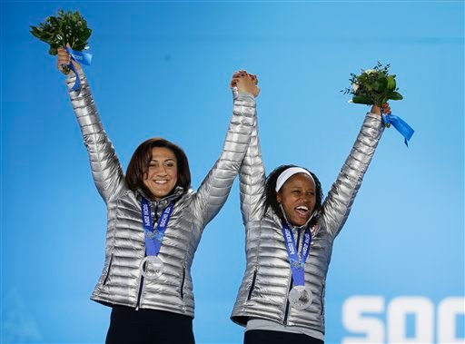Women's bobsleigh silver medalists Elana Meyers, left, and Lauryn Williams of the United States celebrate during their medals ceremony at the 2014 Winter Olympics, Thursday, Feb. 20, 2014, in Sochi, Russia. (AP Photo/David Goldman)