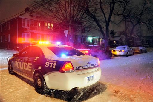 In this Thursday, Jan. 16, 2014 file photo, Detroit Police vehicles are parked in a neighborhood in Detroit where a 4-year-old boy was shot by his 4-year-old cousin with a rifle according to police. (AP Photo/Detroit News, Jose Juarez)