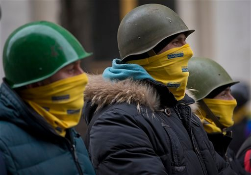 Protesters stand guard in front of presidential administrative building in central Kiev, Ukraine, Saturday, Feb. 22, 2014.