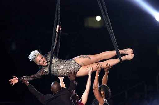 In this Jan. 26, 2014 file photo, Pink performs at the 56th annual Grammy Awards at Staples Center, in Los Angeles.