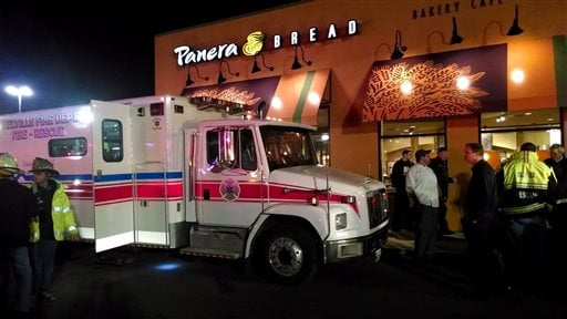 First responders stand outside Panera Bread's store at the Walt Whitman Mall in Huntington Long Island, New York late Saturday Feb. 22, 2014.