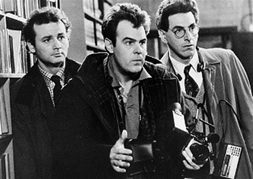 """In an undated file photo, Bill Murray, Dan Aykroyd, center, and Harold Ramis, right, appear in a scene from the 1984 movie """"Ghostbusters""""."""