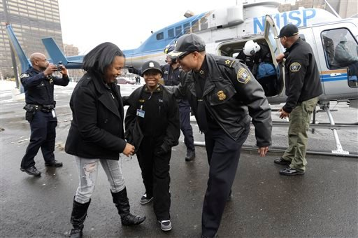 On Jan. 31, 2014, Jayvon Felton, center, becomes Chief of Police for a day with Detroit Police Chief James Craig, right, and mother Amanda Clinkscales, as he gets off a Michigan State Police helicopter at Detroit Public Safety headquarters in Detroit.