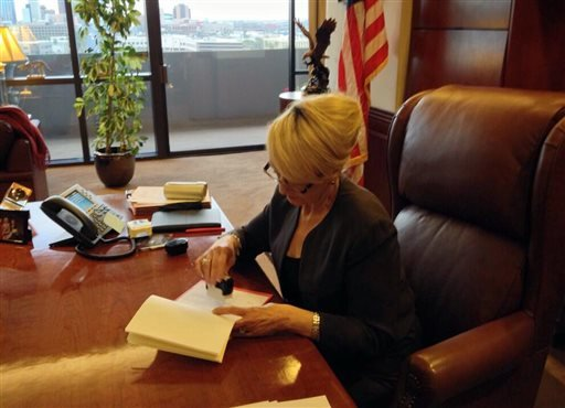 In this photo tweeted by the office of Arizona Gov. Jan Brewer, Brewer vetoes Senate Bill 1062. (AP Photo/Office of Arizona Gov. Jan Brewer)