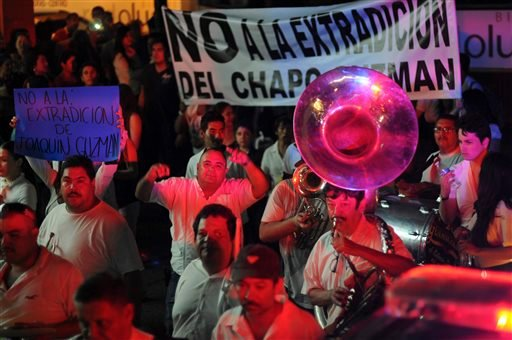 "People play music and march in support of jailed top drug boss Joaquin Guzman Loera, ""El Chapo"" in the city of Culiacan, Mexico, Wednesday Feb. 26, 2014."