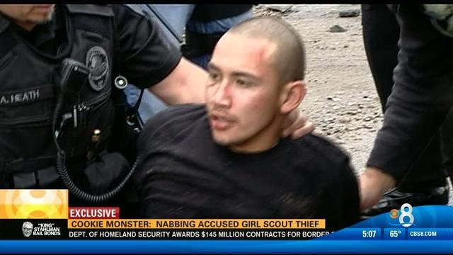 Accused thief David Betancourt being taken into custody Thursday.