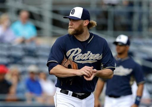San Diego Padres' Andrew Cashner (34) walks back onto the mound between pitches to the Seattle Mariners in the second inning of an exhibition baseball game, Friday, Feb. 28, 2014, in Peoria, Ariz. (AP Photo/Tony Gutierrez)