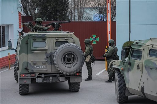 Troops in unmarked uniforms stand guard as they take control the Coast Guard offices in Balaklava on the outskirts of Sevastopol, Ukraine, Saturday, March 1, 2014. (AP Photo/Andrew Lubimov)