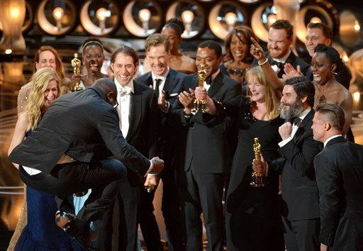 "Director Steve McQueen, left, celebrates with the cast and crew of ""12 Years a Slave"" as they accept the award for best picture during the Oscars."