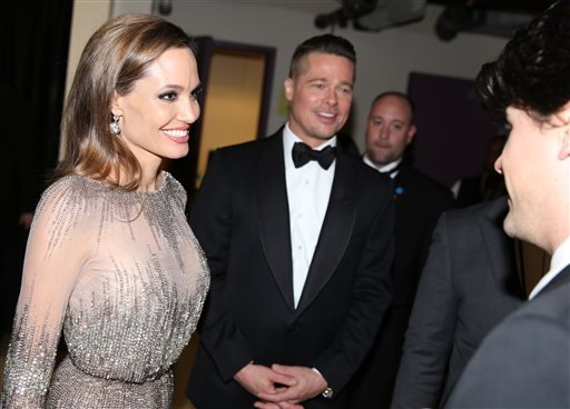 Angelina Jolie, left, and Brad Pitt appear at the Oscars on Sunday, March 2, 2014, at the Dolby Theatre in Los Angeles.